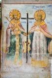 Helgon på väggarna av kloster Arkivfoto