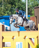 HELGON PETERSBURG-JULY 06: Rider Andis Varna på Coradina i cet Royaltyfri Fotografi