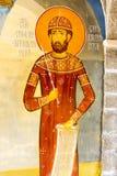 Helgon Stephan i den vägg- målningen i templet i kloster Rezevici i Montenegro Arkivbild