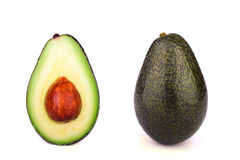 Helhet och halv avokado som isoleras på vit Royaltyfria Bilder