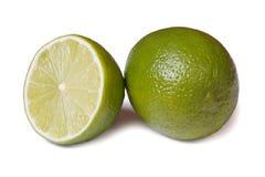 Helhet och halv ny limefrukt som isoleras på vit bakgrund royaltyfria foton