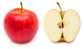 Helhet och halvt äpple royaltyfria bilder