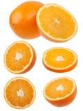 Helhet och klippta apelsiner Arkivbild