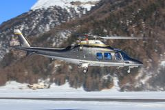 Heli Bernina AG. Samedan/Switzerlad: Heli Bernina AG AS-350B-3 Ecureuil at Engadin Airport in Samedan/Switzerland 18.02.2017 Royalty Free Stock Photos