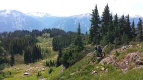 Heli drop biking on Rainbow Mountain. In Whistler bike park, British Columbia Canada Stock Image