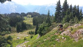 Heli drop biking on Rainbow Mountain. In Whistler bike park, British Columbia Canada Royalty Free Stock Image