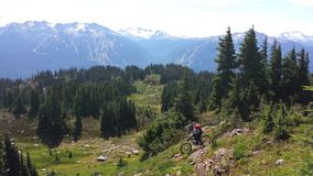 Heli drop biking on Rainbow Mountain. In Whistler bike park, British Columbia Canada Stock Photography
