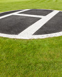 Heli pad. Helicopter landing spot in the grass Royalty Free Stock Image