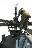 Heli service. A soldier inspecting a heli rotor stock photo