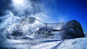 Heli ski, helicopter take off royalty free stock images