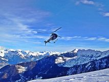 Heli ski. A helicopter about to land for a heli skiing adventure in Switzerland Stock Photos