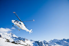 Heli Skiing Helicopter. Is landing on a ski slope in Gressoney Ski Resort, Aosta, Italy Stock Photos