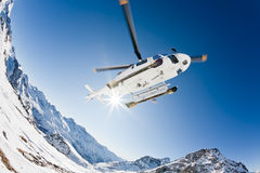 Heli Skiing Helicopter. Is landing on a ski slope in Gressoney Ski Resort, Aosta, Italy Stock Image