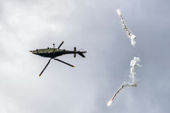 Helicóptero Augusta A-109 y llamaradas Imágenes de archivo libres de regalías