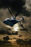 Helicóptero en la puesta del sol Foto de archivo libre de regalías