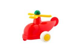 Helicóptero plástico rojo, juguete del bebé aislado en blanco foto de archivo libre de regalías