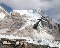 Helicopper in Mount Everest base camp and mount Nuptse Stock Photography