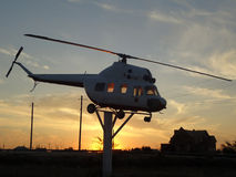 Helicopte. MI-2 on a pedestal against the sunset sky Stock Photo