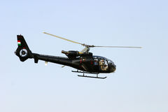 Helicopter. Flying with blue sky in the background Royalty Free Stock Image