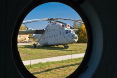 Helicopter. A big helicopter through a small porthole Royalty Free Stock Photography