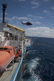 Helicopter. Departing of an helicopter in a seismic vessel in offshore area Stock Images