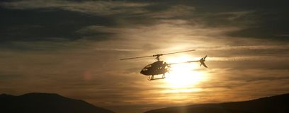 Helicopter. Model with sunset background stock photos