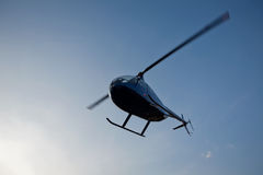 Helicopter. Small helicopter in blue sky royalty free stock photography