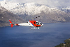 Helicopter. Aerial view of a helicopter flying over water in mountainous landscape Stock Photos