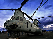 Helicopter. A military helicopter on the deck of an aircraft carrier Royalty Free Stock Images