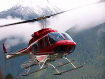 Helicopter. A helicopter near mountains Stock Photography