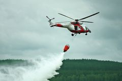 Helicopter. Helicpter dropping water on a fire Stock Photo