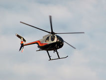 Helicopter. Flying in cloudy sky