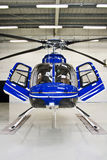 Helicopter. Private brand new helicopter in a hangar Stock Photos