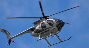 Helicopter. A Sheriff Helicopter patrolling the sky stock photo