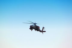 Helicopter. Flying into a clear blue sky Royalty Free Stock Image