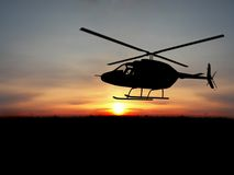 Helicopter. Silhoutte  helicopter over orange sunset Royalty Free Stock Images