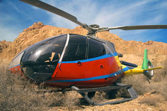 Helicopter. Small helicopter in the mountains Royalty Free Stock Image