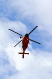 Helicopter. Red And White Fire Rescue Chopper Against A Blue Cloudy Sky Stock Photos