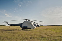 Helicopter. Covered with a tarpaulin cover of a helicopter at a sports airfield Stock Images