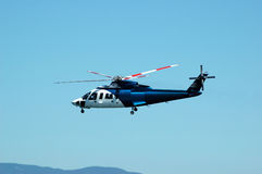 Helicopter. A passenger helicopter for tourists soaring in the sky Stock Photo