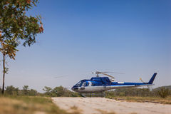 Helicopter. A helicopter parked on grass Stock Photography