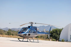 Helicopter. A helicopter parked on ground Stock Photography