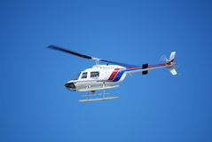 Helicopter. White helicopter with blue and red streaks Royalty Free Illustration