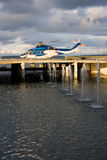 Helicopter. A photo of passenger helicopter waiting to take off from the platform behind fountains Royalty Free Stock Photo