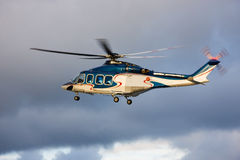Helicopter. A photo of passenger helicopter just took off, wheels still out Royalty Free Stock Photography
