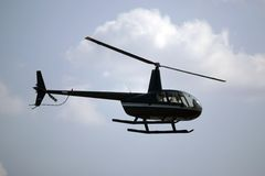 Helicopter. Small helicopter taking off royalty free stock photos