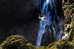 Helicopter above Fiordland Stock Photos