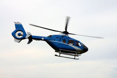 Helicopter in action. Detail of blue helicopter in action Royalty Free Stock Photos