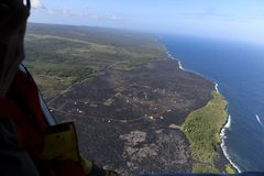 Helicopter aerial view of lava field by the ocean, Big Island, Hawaii.  Royalty Free Stock Photo