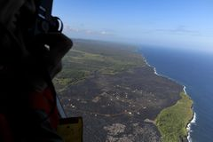Helicopter aerial view of lava field by the ocean, Big Island, Hawaii.  Stock Photography